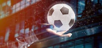 Equipaggi la tenuta del renderin della palla e del collegamento 3d di calcio Immagini Stock