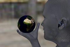 Equipaggi la tenuta e lo sguardo del mondo in sua mano destra Fotografia Stock Libera da Diritti
