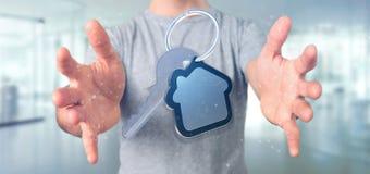 Equipaggi la tenuta una chiave e della rappresentazione della casa 3d Fotografie Stock