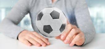 Equipaggi la tenuta una palla di calcio e del renderin isolato il collegamento 3d Immagine Stock Libera da Diritti