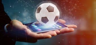 Equipaggi la tenuta una palla di calcio e del renderin isolato il collegamento 3d Fotografia Stock Libera da Diritti