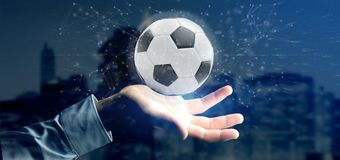 Equipaggi la tenuta una palla di calcio e del renderin isolato il collegamento 3d Immagini Stock
