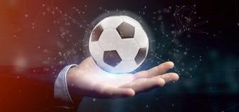 Equipaggi la tenuta una palla di calcio e del renderin isolato il collegamento 3d Immagine Stock