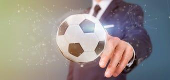 Equipaggi la tenuta una palla di calcio e del renderin isolato il collegamento 3d Immagini Stock Libere da Diritti