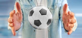 Equipaggi la tenuta una palla di calcio e del renderin isolato il collegamento 3d Fotografie Stock
