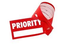 Equipaje de la escritura de la etiqueta de la prioridad - vuelo de la clase de asunto Fotos de archivo libres de regalías