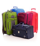 Equipaje que consiste en las maletas aisladas en blanco Foto de archivo