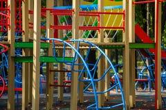 Equipamento colorido do campo de jogos para o parque das crianças em público Fotos de Stock Royalty Free