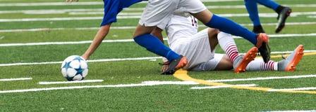 Equipamento de corrediça durante o jogo de futebol Fotos de Stock Royalty Free