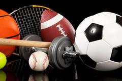 Equipamento de esportes Assorted no preto Fotografia de Stock Royalty Free