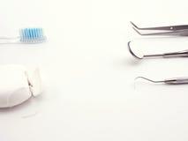 Equipamento dental no fundo branco Imagens de Stock