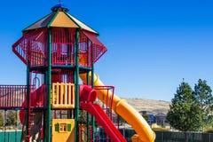 Equipamento do campo de jogos das crianças modernas com corrediças Foto de Stock Royalty Free