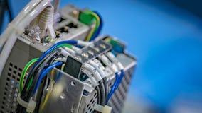 Equipamento elétrico das tomadas no dispositivo imagens de stock