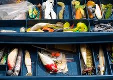 Equipamentos de pesca coloridos na caixa especial Fotografia de Stock Royalty Free