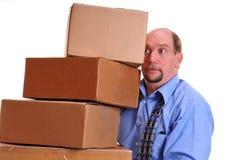 Equipe as caixas pesadas carreg que esperam não as deixar cair Foto de Stock Royalty Free