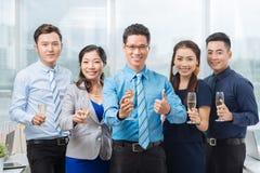 Equipe asiática alegre do negócio Foto de Stock Royalty Free