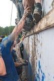A equipe ataca a parede grande na raça do extrim Tyumen Rússia Fotos de Stock