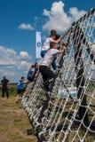 A equipe ataca a parede líquida na raça do extrim Tyumen Rússia Fotos de Stock