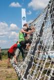 A equipe ataca a parede líquida na raça do extrim Tyumen Rússia Fotos de Stock Royalty Free