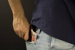 Equipe a colocação da carteira com dinheiro brasileiro dentro do bolso Fotografia de Stock Royalty Free