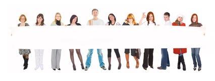 Equipe com um poster em branco Fotos de Stock Royalty Free