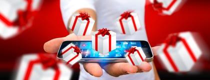 Equipe a comemoração do Natal que guarda o presente em sua mão Imagens de Stock Royalty Free