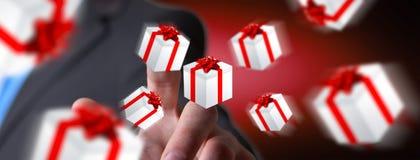 Equipe a comemoração do Natal que guarda o presente em sua mão Imagens de Stock
