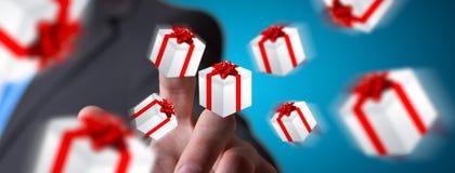 Equipe a comemoração do Natal que guarda o presente em sua mão Foto de Stock