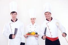 Equipe de cozinheiros chefe felizes Imagens de Stock