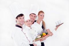 Equipe de cozinheiros chefe felizes Fotografia de Stock Royalty Free