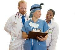Equipe de funcionários médica dos cuidados médicos três fotos de stock