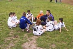 Equipe de futebol das crianças com treinador Foto de Stock Royalty Free
