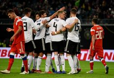 Equipe de futebol nacional alemão que comemora um objetivo marcado em inter fotos de stock royalty free