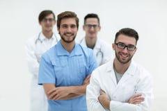 Equipe de sorriso de doutores novos Fotografia de Stock Royalty Free