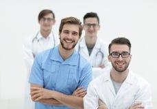 Equipe de sorriso de doutores novos Fotografia de Stock