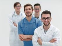 Equipe de sorriso de doutores novos Imagem de Stock