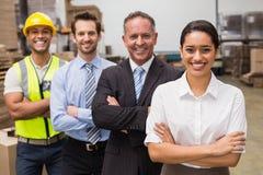 Equipe do armazém que sorri na câmera Fotografia de Stock