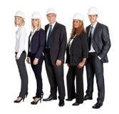 Equipe do engenheiro civil seguro contra o branco imagem de stock royalty free