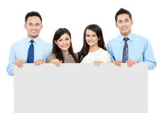 Equipe do negócio com o cartão vazio grande Imagens de Stock Royalty Free