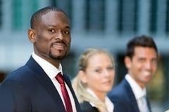 Equipe do negócio: grupo de executivos novos Fotos de Stock Royalty Free