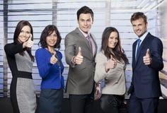 Equipe do negócio que dá os polegares acima Fotografia de Stock