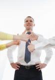 Equipe do negócio que mostra os polegares acima Imagem de Stock Royalty Free