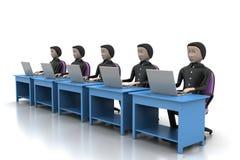 Equipe do negócio que olha um portátil Fotografia de Stock Royalty Free