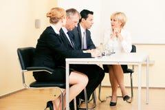Equipe do negócio que tem a reunião Foto de Stock Royalty Free