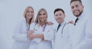 Equipe dos profissionais médicos que olham a câmera, sorrindo Imagem de Stock Royalty Free