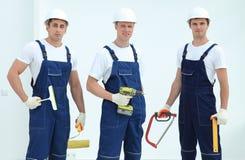 Equipe dos trabalhadores da construção com ferramentas de funcionamento Imagem de Stock Royalty Free
