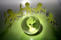 Equipe e globo Imagens de Stock
