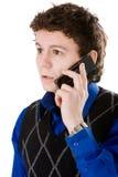 Equipe a fala com o telefone móvel isolado no branco Fotos de Stock Royalty Free