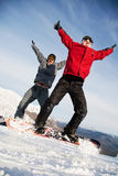 Equipe feliz da snowboarding Fotos de Stock Royalty Free