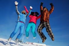 Equipe feliz da snowboarding Imagem de Stock